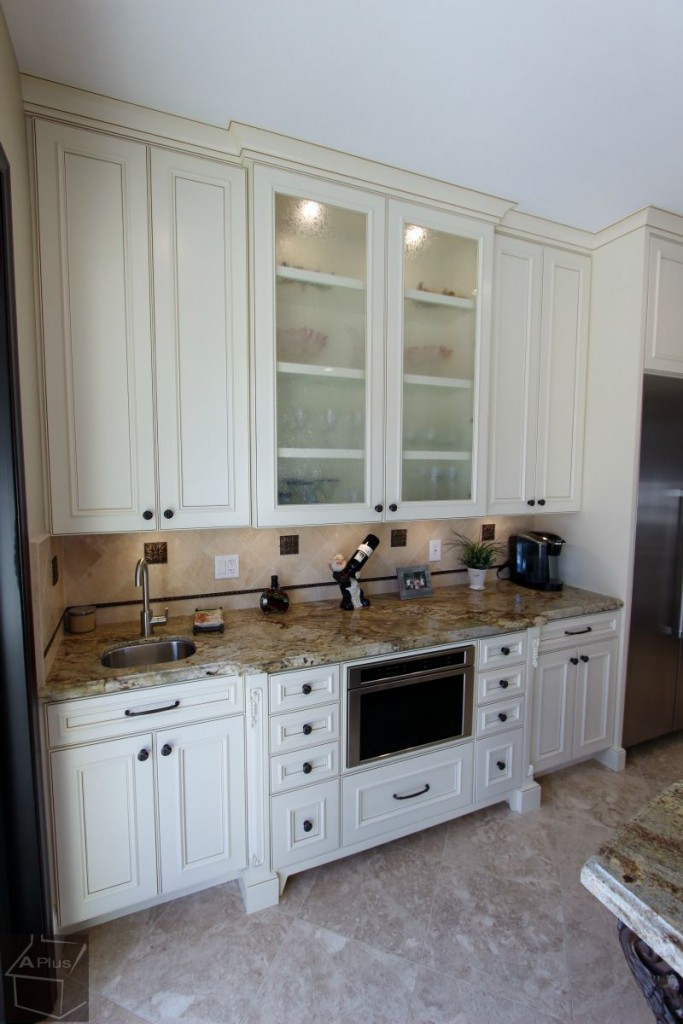 traditional 2-section white & brown kitchen remodel with custom cabinets