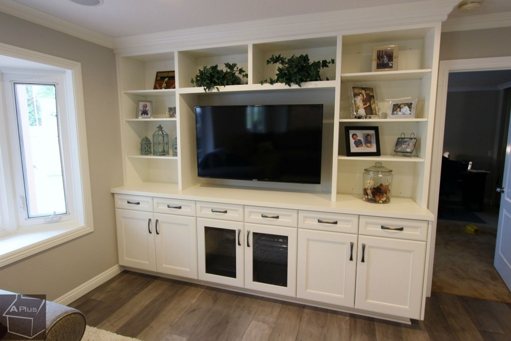 Entrtainment center with custom white cabinets